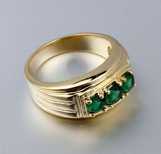 Позолоченное кольцо с искусственными изумрудами